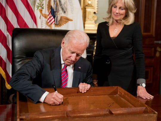 Vice President Joe Biden signs the drawer of the vice