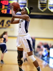 Launching a shot for Wayne Memorial on Thursday night is senior forward Amara Chikwe (2). She scored four points in the game against Hartland.