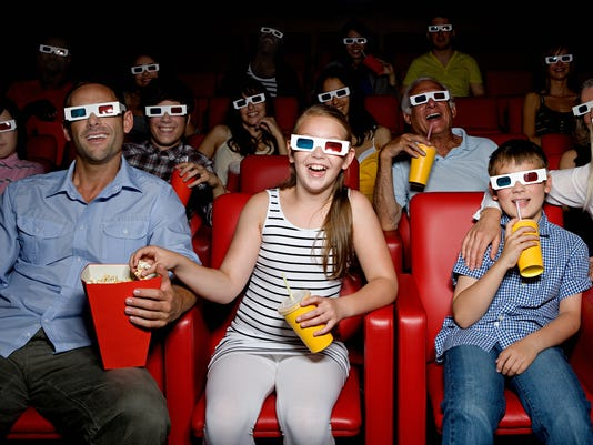 Family watching 3d movie at the movie theater