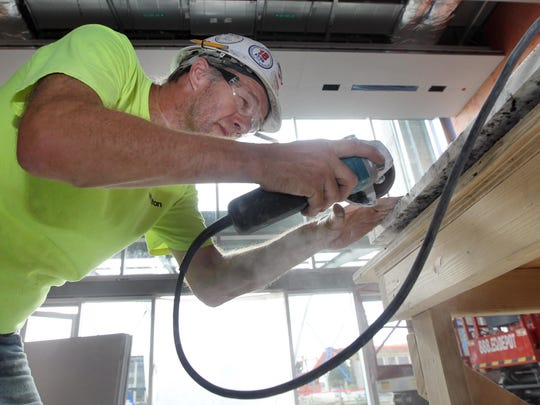 Don Taylor, a tilesetter with T.H. Winston Co., prepares