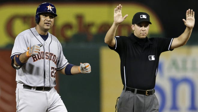 Houston Astros catcher Carlos Corporan celebrates on second base after a two-run double against the Texas Rangers on July 9, 2014, in Arlington, Texas.