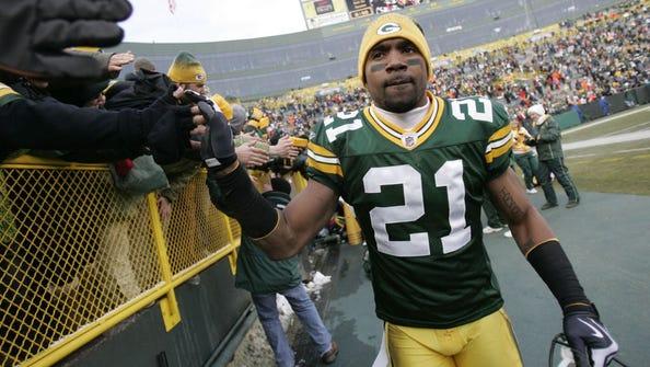Green Bay Packers cornerback Charles Woodson celebrates