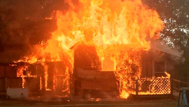 Flames engulf Davenport's family home in the 3700 block of Bowker Road during firefighter training and a country music video shoot in early October.
