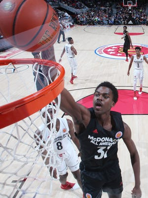 McDonalds All American East forward Kris Wilkes (31) dunks during the 40th Annual McDonald's High School All-American Game at the United Center.