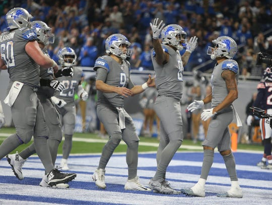 Lions QB Matthew Stafford (9), TE Eric Ebron (85) and