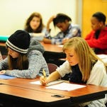 Students take part in a lesson at the Early College Academy in Lafayette, a dual enrollment program that awards a high school diploma and associate's degree. The state is striving to offer more college and career preparation pathways for high school students.