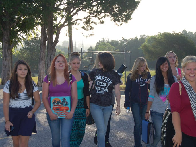 A group of girls head into MHJHS as the first bell of the year rings.