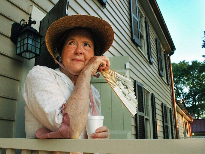 Reenactor Peggy Govan greats guests at the Douglass-Clark House dedication on Monday, July 21, 2014 in Gallatin.