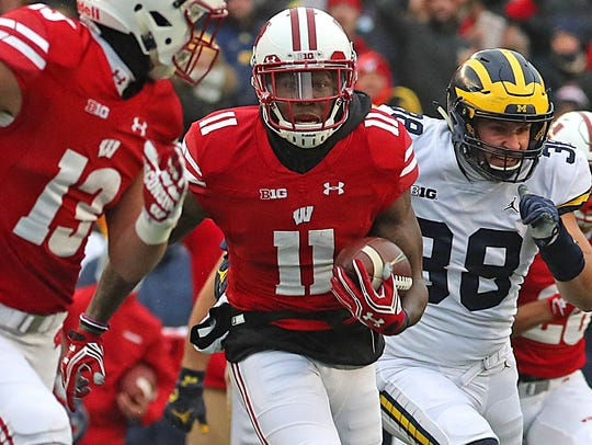 Wisconsin's Nick Nelson returns a punt 50 yards for a touchdown in the game against Michigan last November in Madison.