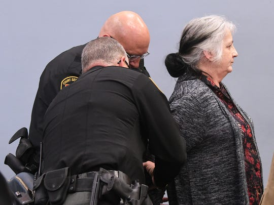 Linda Buckner is handcuffed after being found guilty on all counts on Wednesday afternoon.