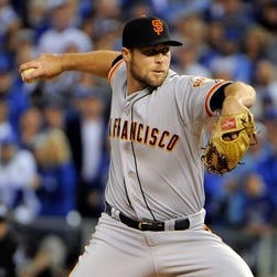 Hunter Strickland throws a pitch against the in the sixth inning during Game 2.