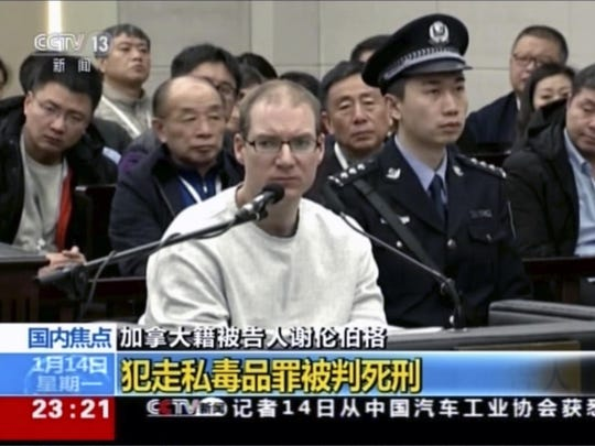 In this image taken from a video footage run by China's CCTV, Canadian Robert Lloyd Schellenberg attends his retrial at the Dalian Intermediate People's Court in Dalian, northeastern China's Liaoning province on Jan. 14, 2019. A Chinese court sentenced the Canadian man to death Monday in a sudden retrial in a drug smuggling case that is likely to escalate tensions between the countries over the arrest of a top Chinese technology executive.