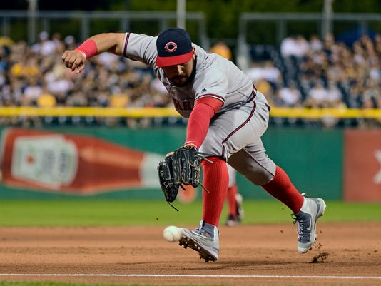 Cincinnati Reds' Eugenio Suarez cannot reach a batted ball by Pittsburgh Pirates' Josh Harrison in the third inning of a baseball game in Pittsburgh, Friday, Sept. 9, 2016. Harrison reached second on the hit. (AP Photo/Fred Vuich)