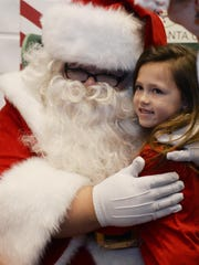 Audrey Nowaczyk, 7, of Howell poses with Scott Powers,