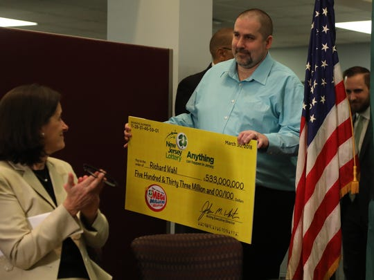 The winner of the $533 million lottery, Richard Wahl of Vernon comes to lottery headquarters to accept his check.