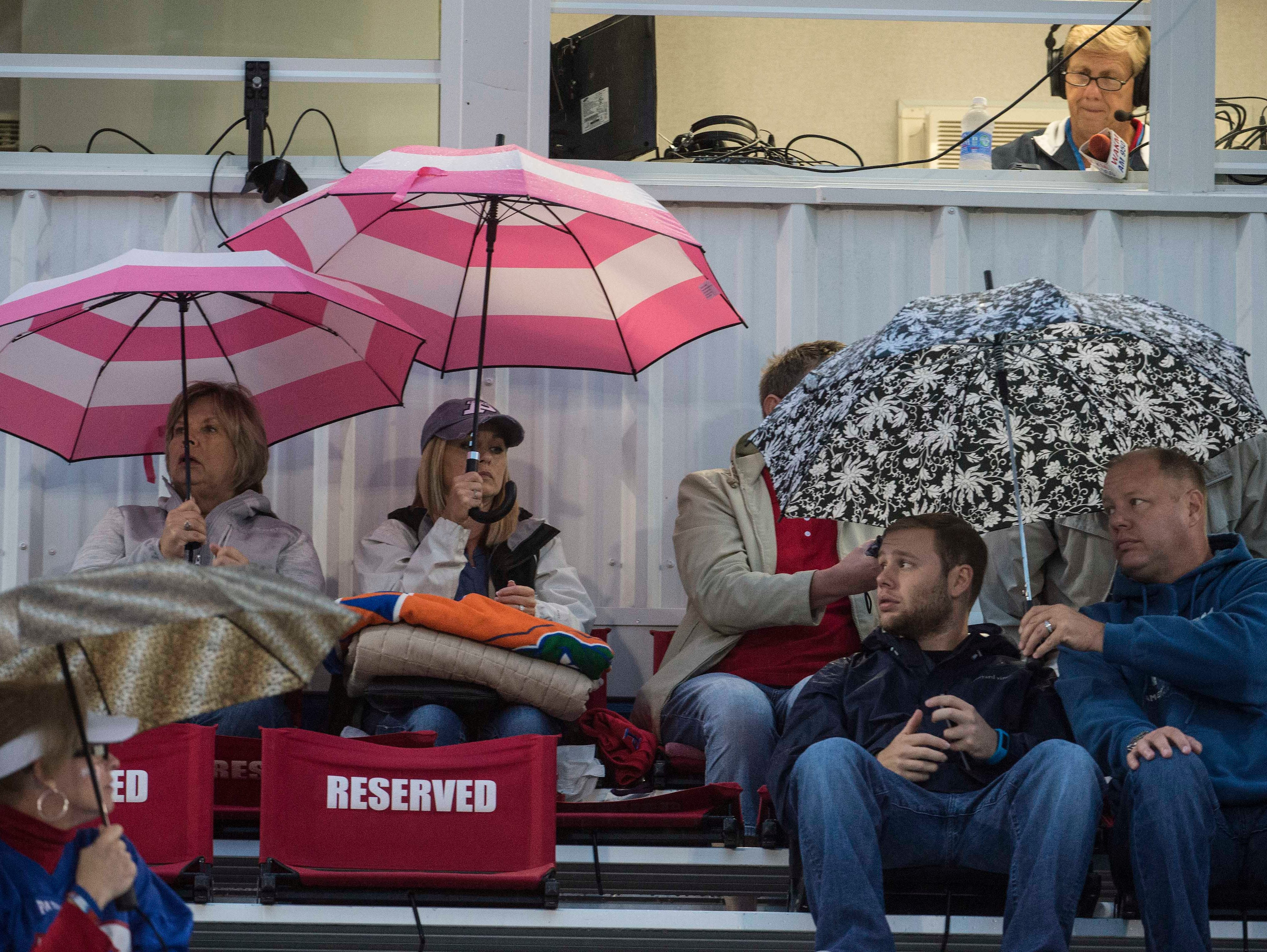 Page fans try to keep dey in the rain during the Page High School on Friday Sept. 25, 2015, in Franklin in Tenn.