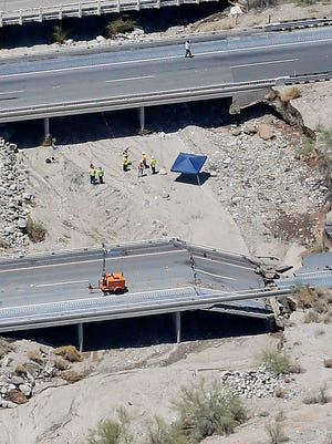 This aerial photo shows the collapsed elevated section of Interstate 10, July 20, 2015, in Desert Center, Calif. Members of Congress have cited this bridge collapse as an example of why lawmakers should pass a long-term highway funding bill.