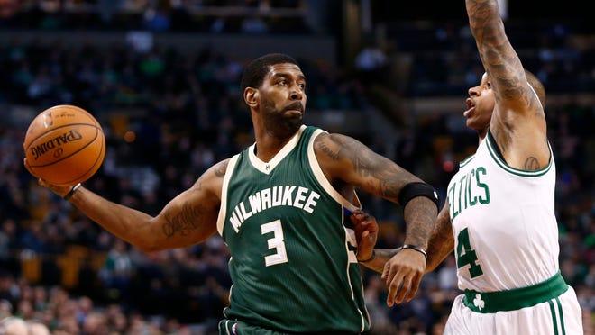 Feb 25, 2016; Boston, MA, USA; Milwaukee Bucks guard O.J. Mayo (3) passes the ball as Boston Celtics guard Isaiah Thomas (4) defends during the first half at TD Garden. Mandatory Credit: Mark L. Baer-USA TODAY Sports
