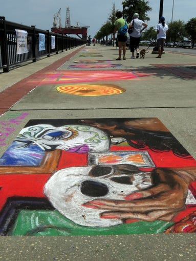 The Chalk It Up!  Pensacola Sidewalk Art Festival was held Saturday morning on the sidwalks of the Commendencia Slip at the end of Jefferson Street.