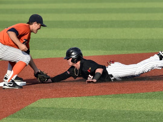 Louisville's Sutton Whiting, right, is tagged out by Cal State Fullerton's Taylor Bryant while attempting to steal second during the first inning in the super regional of the NCAA college baseball tournament, Monday, June 8, 2015, in Louisville, Ky.