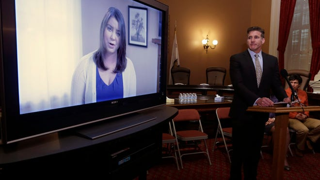 In this March 25, 2015 file photo, Dan Diaz, husband of Brittany Maynard, watches a video of his wife, recorded 19 days before her assisted suicide death during a news conference in Sacramento, Calif. In it, she says that she should not have to leave her home to legally end her life.