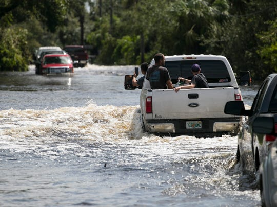 Only trucks could make it through the deep water blocking Cemetery Road in Buckingham on Monday following Hurricane Irma.