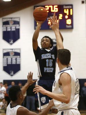 Kenneth Jones (15) of Mater Dei shoot over Ranney School defenders during boys basketball game at Ranney School, Monday, February 6 ,2017.  Tinton Falls,NJ.  Noah K. Murray-Correspondent/Asbury Park Press ASB 0207 Boys Hoops Gamer
