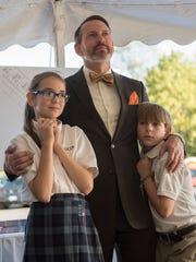 Nate Grubaugh, with his children Amaris and Joshua,