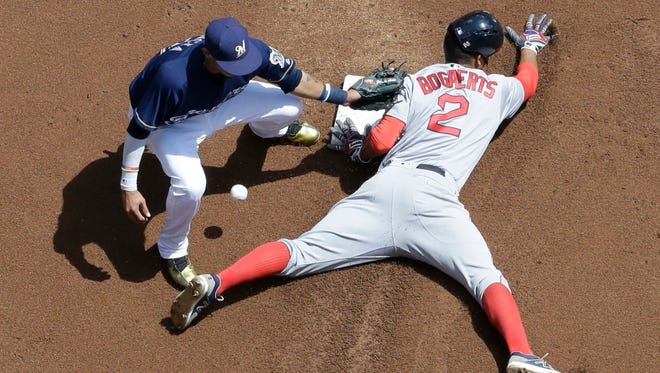 Orlando Arcia can't handle the throw as Boston's Xander Bogaerts steals second during the first inning Thursday at Miller Park.