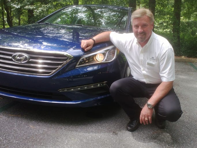 Hyundai U.S. CEO David Zuchowski shows off 2015 Sonata Eco model at Purcell Farms, Sylacauga,  Ala., near the Hyundai plant. With a new 1.6-liter turbo four and 7-speed dry clutch automatic, the high-mileage model will have a 32 mpg combined rating.