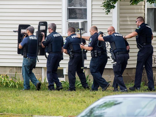 Police move in on a house they surrounded on Cayuga Court in Burlington on Thursday, September 8, 2016.