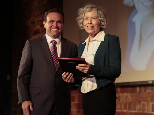 City of Cincinnati Mayor John Cranley awards Peg Fox, executive director of Metropolitan Area Religious Coalition of Cincinnati and Catholic Charities, with the Humanitarian of the Year award during the 2016 State of the City speech, Tuesday, Oct. 4, 2016, at the 20th Century Theater in Oakley.