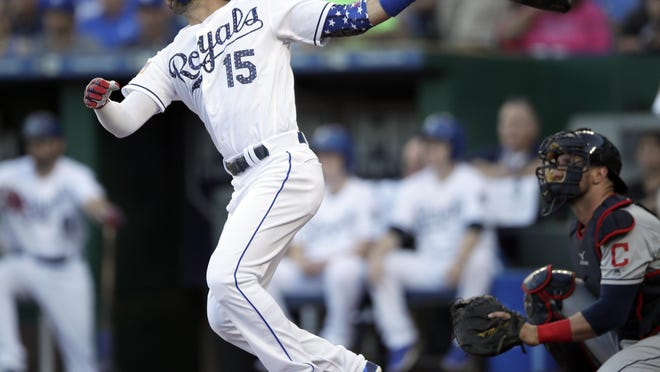 Kansas City Royals' Whit Merrifield hits a solo home run against Cleveland on Monday, July 2, 2018.