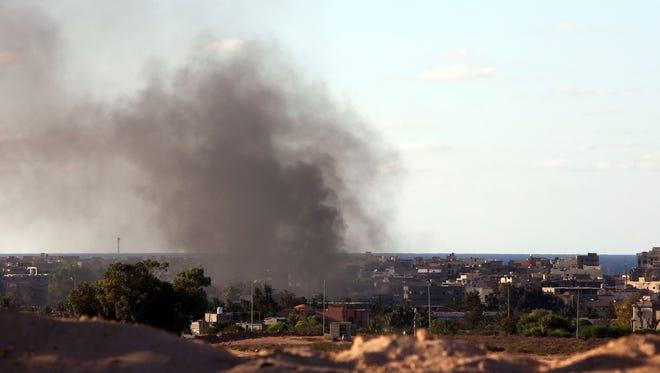 Smoke billows from fighting in Sirte in July.