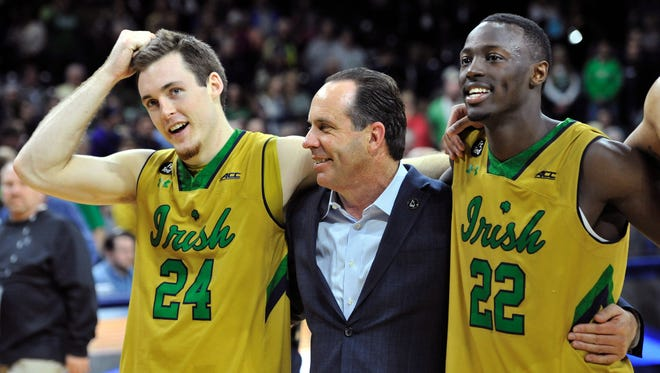 From left, Notre Dame guard Pat Connaughton, coach Mike Brey and guard Jerian Grant enjoyed a victory over Clemson in South Bend on March 7.