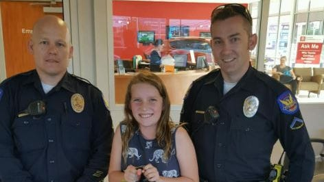 Phoenix police Officers Tom Gallagher and Kyle Cosner got with the Arizona Diamondbacks to replace a stolen backpack for 10-year-old Aleksia.