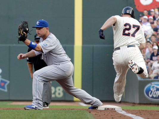 Minnesota Twins' Chris Parmelee (27) grounds into an inning-ending double play with the bases loaded as Kansas City Royals first baseman Billy Butler makes the force-out at first during the second inning of a baseball game, Saturday, Aug. 16, 2014, in Minneapolis. AP Photo/Paul Battaglia)