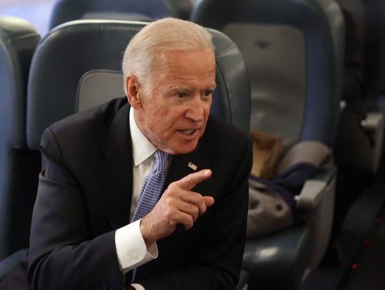Vice President Joe Biden chats with colleagues on an