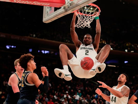 FILE - In this March 3, 2018, file photo, Michigan State forward Jaren Jackson Jr. (2) dunks the ball against Michigan during the first half of an NCAA Big Ten Conference tournament semifinal college basketball game,  in New York. Michigan State freshman Jaren Jackson is entering the NBA draft. Jackson announced his decision on Twitter on Monday, April 2, 2018, several hours before the national championship game.(AP Photo/Julie Jacobson, File)
