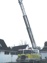 The ladder is stretched out to its full length for the public to see during the Bronson Fire Department's Open House.