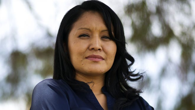 Navajo Amanda Blackhorse of Phoenix is part of a legal action against the Washington NFL team and their name/logo/mascot. She is seen in Phoenix on Wednesday, May 8, 2013. David Wallace/The Arizona Republic