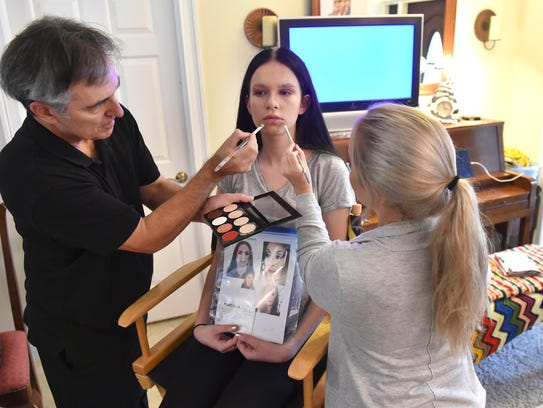 Emilee Dickhart, 15, (center), begins her transformation