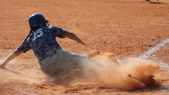 Madison's Sabrina Moorefield slides into home plate.