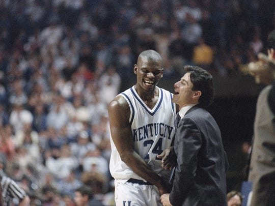 UK coach Rick Pitino shares a light moment with Jamal Mashburn after their 1993 SEC championship win vs. LSU.
