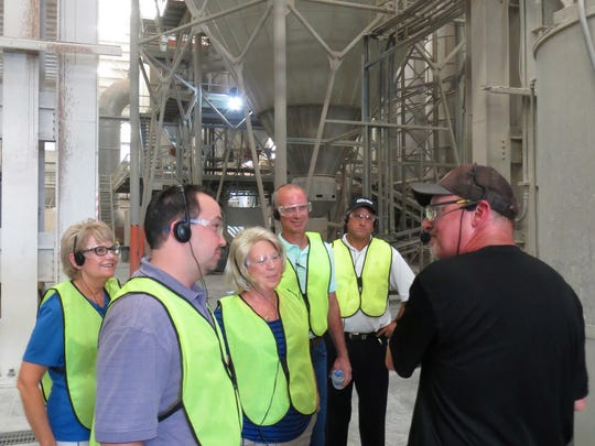 Visitors from Dickson, including, front, new Chamber of Commerce CEO Joey Graves, listen to the Dal-Tile staff.