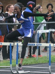 Garden City hurdler Tionna Thompson won the high hurdles race Tuesday and placed second in the 300 lows.