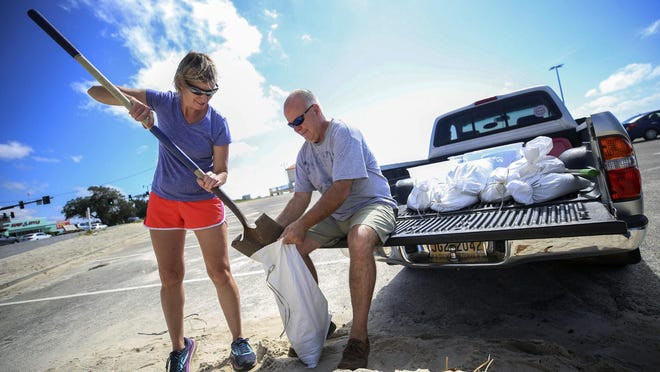 Mississippi Coast residents spent Sunday morning filling sandbags in preparation for Tropical Storm Sally. Kim Miller and Monty Graham opened their truck bed and began loading up bags along U.S. 90 in Gulfport. They said last time they prepped for Laura and Marco they had to use construction bags after locations ran out. Alyssa Newton / Sun Herald
