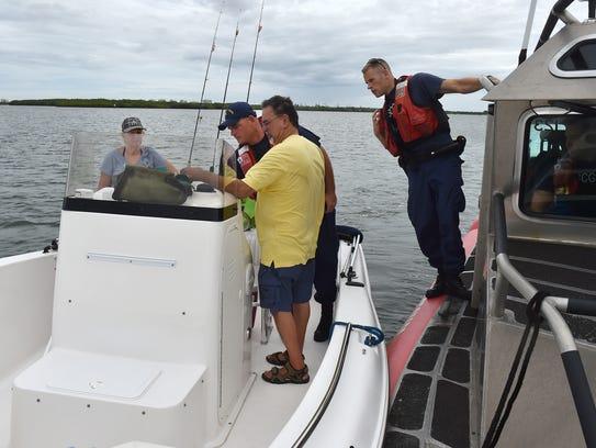 U.S. Coast Guard Petty Officers Second Class Raymond
