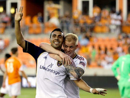 Real Salt Lake's Javier Morales, left, celebrates with Luke Mulholland, right, after scoring his third goal of the game against the Houston Dynamo during the second half of a MLS soccer game Sunday, May 11, 2014, in Houston. Real Salt Lake won 5-2. (AP Photo/David J. Phillip)