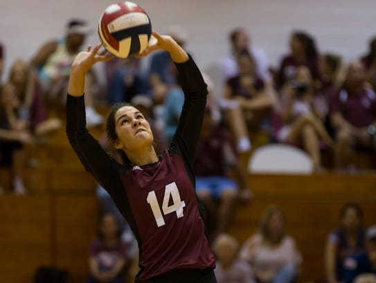 Flour Bluff's Cali Nims sets the ball during the second
